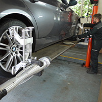 technician conducting wheel alignment